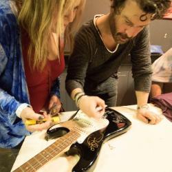 Doyle Bramhall II signing guitar