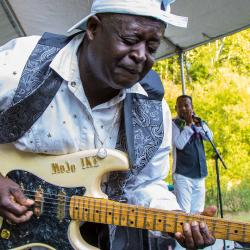 Ike Woods playing his guitar at New River Blues Festival