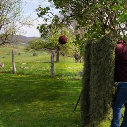 Kim Shooting with a Ghillie Blanket for Cover
